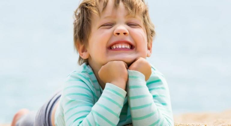Happy-toddler-on-the-beach-gentle-healing